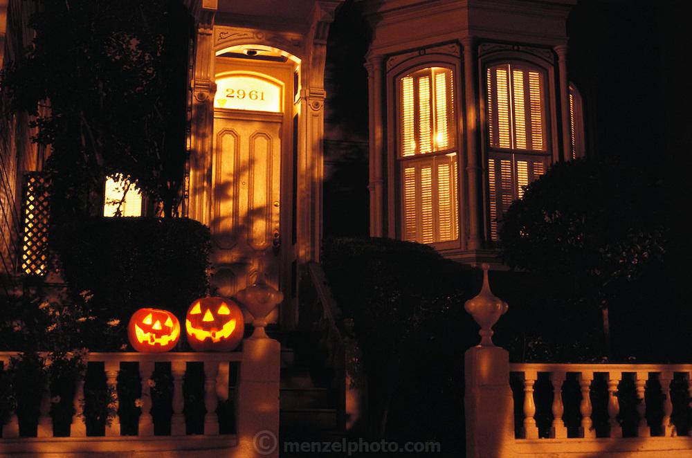 Halloween pumpkins on a Victorian house railing. San Francisco, California.