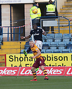 24th February 2018, Dens Park, Dundee, Scotland; Scottish Premier League football, Dundee versus Motherwell; Genseric Kusunga of Dundee towers above Curtis Main of Motherwell as he heads clear