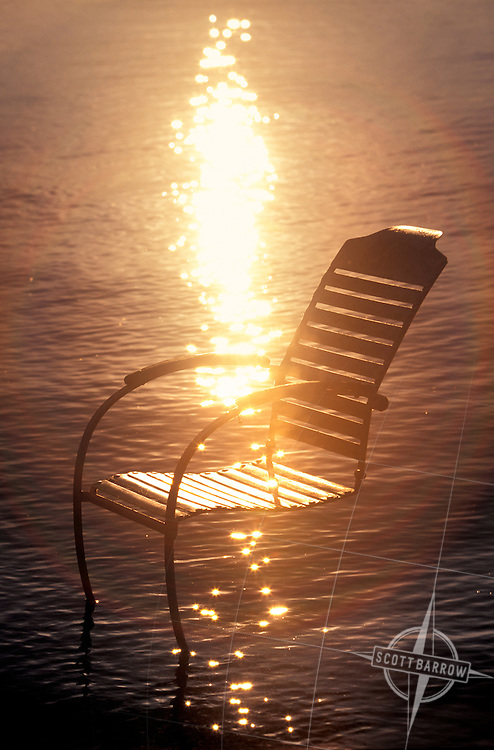 Metal lawn rocking chair in a lake