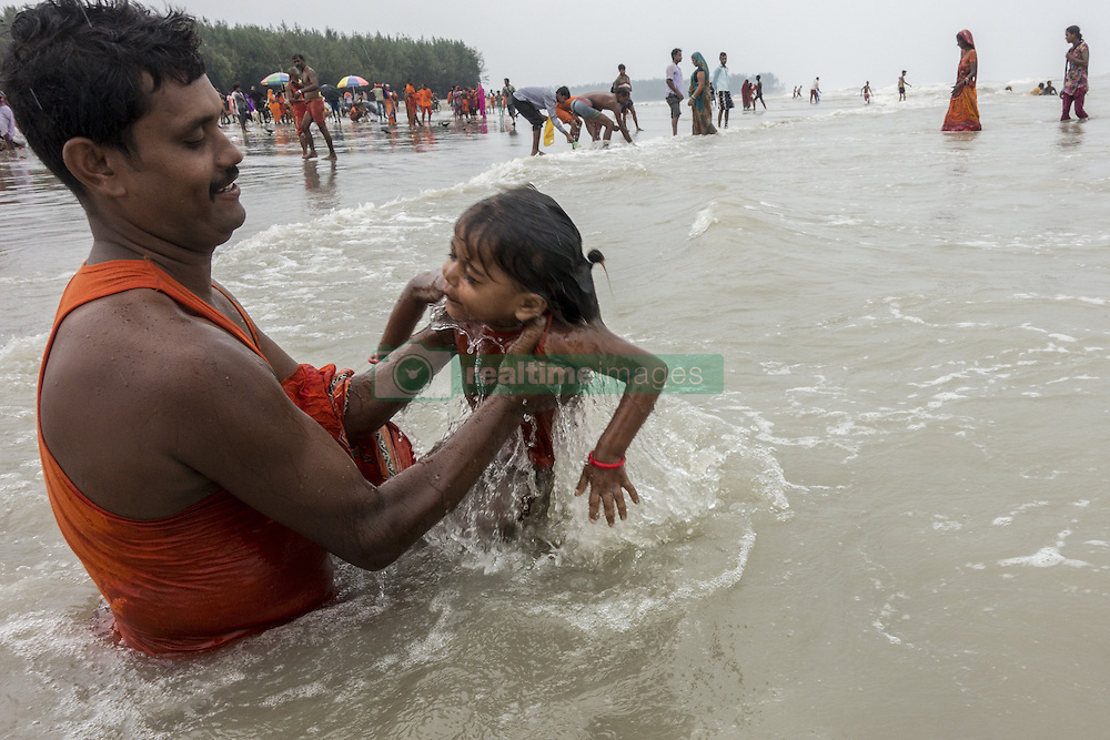 KOLKATA, Aug. 9, 2016 (Xinhua) -- Indian Hindu devotees take holy dip before offering prayers to Lord Shiva, Hindu god of destruction, during Shravan festivities at the confluence of the River Ganges and the Bay of Bengal, some 150 km south of Calcutta, capital of eastern Indian state West Bengal, Aug. 8, 2016. (Xinhua/Tumpa Mondal) .****Authorized by ytfs* (Credit Image: © Tumpa Mondal/Xinhua via ZUMA Wire)