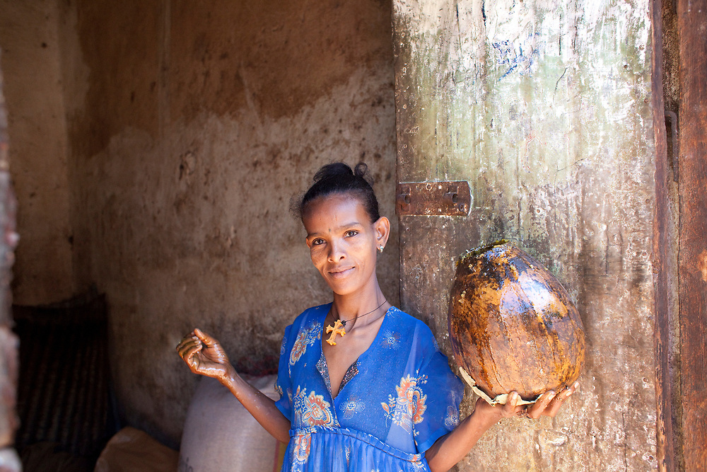 A woman from Maitsebri, living with HIV, makes her living by running a successful honey business .