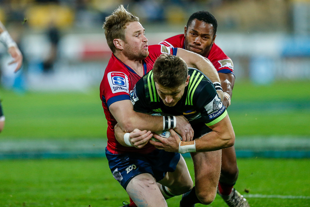 Beauden Barrett tackled during the Super rugby union game (Round 14) played between Hurricanes v Reds, on 18 May 2018, at Westpac Stadium, Wellington, New  Zealand.    Hurricanes won 38-34.