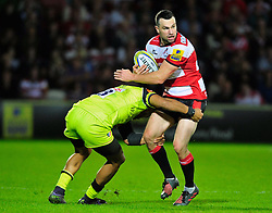 Gloucester's Tom Marshall is tackled by Leicester Tigers Greg Bateman during the Aviva Premiership match at the Kingsholm Stadium, Gloucester.