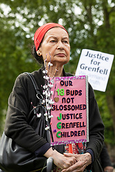 © Licensed to London News Pictures. 14/05/2018. London, UK. A woman at a protest in Parliament Square to mark eleven months since the Grenfell Tower Fire in which 71 people were killed. Photo credit: Rob Pinney/LNP