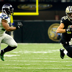 Oct 30, 2016; New Orleans, LA, USA; New Orleans Saints tight end Coby Fleener (82) runs from Seattle Seahawks defensive end Malliciah Goodman (54) during the second quarter of a game at the Mercedes-Benz Superdome. Mandatory Credit: Derick E. Hingle-USA TODAY Sports