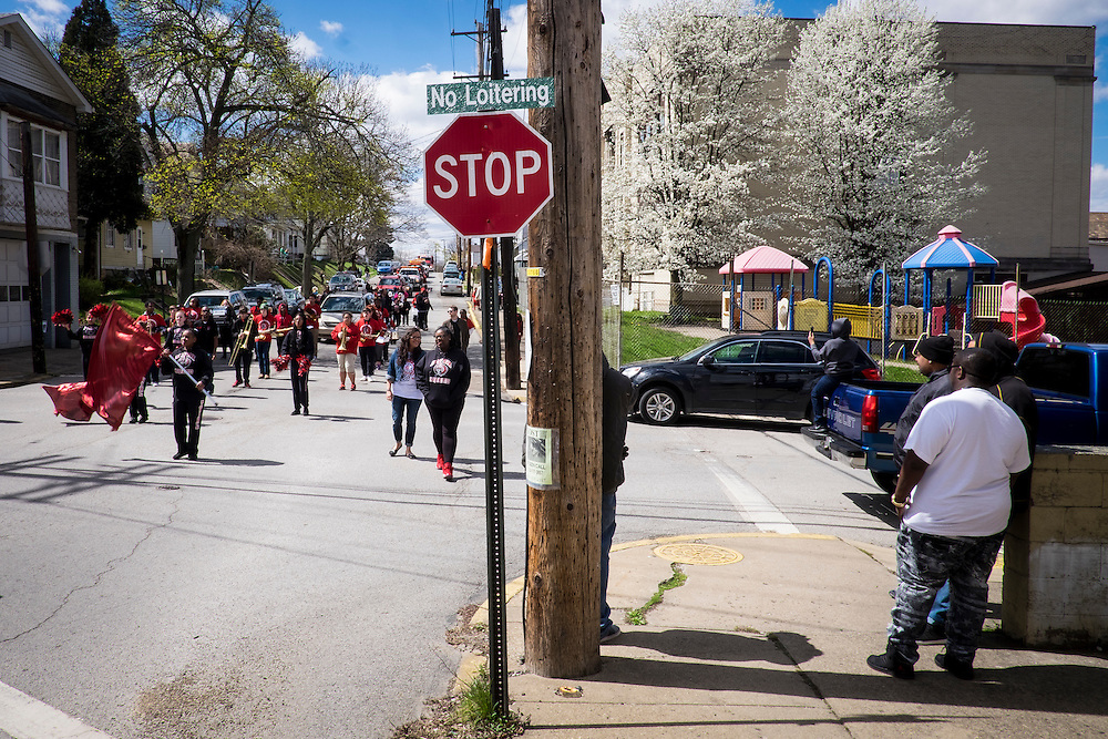 A parade celebrating Aliquippa High School's state championship in boys basketball marches through the Plan 12 neighborhood in Aliquippa.