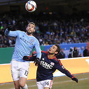 Josh Williams, (left), NYCFC, is challenged by Diego Fagundez, New England Revolution, during the New York City FC v New England Revolution, inaugural MSL football match at Yankee Stadium, The Bronx, New York,  USA. 15th March 2015. Photo Tim Clayton
