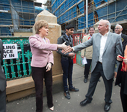 First Minister of Scotland and leader of the SNP Nicola Sturgeon, out on the election trail to make sure people are out voting today, May 7, 2015 in Glasgow, Scotland. With Mohammad Sarwar at Craigie Street Pollokshields polling station.