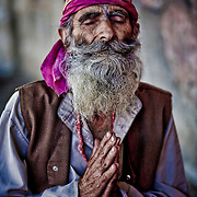 THis Hindu Sadhu sits and prayre out side the Muslim shrine of Shaw-i-Hamdan
