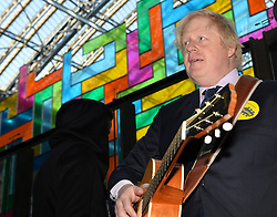Boris Johnson plays the guitar at St Pancras Station.<br /> Mayor of London Boris Johnson joins musicians at St Pancras Station to urge young musicians to take to the streets and continue busking in the Capital.  <br /> <br /> Wednesday, 9th April 2014. Picture by Ben Stevens / i-Images