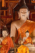 Buddha figures in a Buddhist temple on Inthawarorot Road across the street from the Thai Art & Culture Hall; Chiang Mai, Thailand.