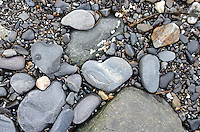 A heart-shaped stone on a rocky beach, Bar Harbor, Maine.