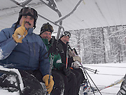 Boyne Highlands Resort general manager Brad Keen (left) lets photographers know that this is the first ski run of the season as he, Boyne Snow Sports Academy director Tony Sendlhoffer (center) and Boyne Resorts vice president of Ski Operations John McGregor (right) take the first chair lift ride to the top of the resorts Heather run to officially start the resorts 2009/10 ski season.