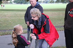 March 16, 2019 - Christchurch, New Zealand - The little girl is the neighbour of the Indonesian man who arranged the vigil with the ambassador, she went around handing out flowers to New Zealanders there to support the Indonesian community. Around 50 people has been reportedly killed a terrorist attack on two Christchurch mosques. (Credit Image: © Adam Bradley/SOPA Images via ZUMA Wire)