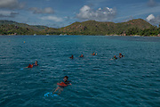 Members of the coral relocation operation swim to a coral nursery during a coral relocation operation off of Curieuse, Seychelles on February 20, 2018. The coral relocation operation is an effort to reduce the effects of coral bleaching caused by the rise in sea temperatures which deeply affected shallow water reefs in parts of the Seychelles.<br /> <br /> The government of Seychelles has created 81,000 square miles of Marine Protected Areas as part of a conservation debt swap deal in an effort to shield marine ecosystems from unsustainable development and climate change while safeguarding its economy.