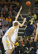 February 19 2011: Michigan Wolverines guard Tim Hardaway Jr. (10) puts up a shot over Iowa Hawkeyes forward Zach McCabe (15) during the first half of an NCAA college basketball game at Carver-Hawkeye Arena in Iowa City, Iowa on February 19, 2011. Michigan defeated Iowa 75-72 in overtime.
