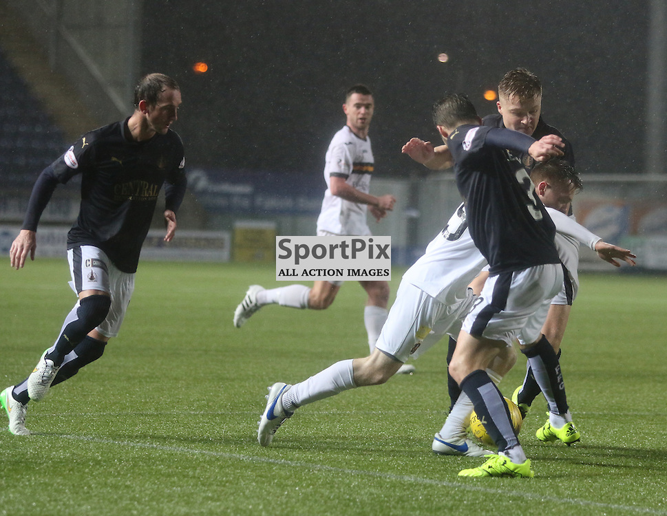 Donald McCallum squeezes through during the Falkirk v Dumbarton  Scottish Championship  26  December 2015 <br /> <br /> (c) Andy Scott | SportPix.org.uk