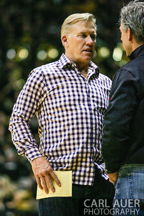 December 7th, 2013:  Former NFL great John Elway at the NCAA Basketball game between the Kansas Jayhawks and the University of Colorado Buffaloes at the Coors Events Center in Boulder, Colorado