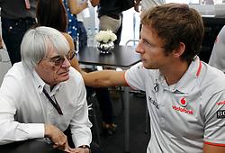 Motorsports / Formula 1: World Championship 2010, GP of Brazil, Bernie Ecclestone (GBR, President and CEO of Formula One Management and Formula One Administration), 01 Jenson Button (GBR, Vodafone McLaren Mercedes),
