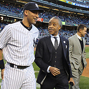 Derek Jeter, New York Yankees, talking with Al Sharpton, an American Baptist minister, civil rights activist, and television/radio talk show host during presentations before the New York Yankees V Chicago Cubs, double header game two at Yankee Stadium, The Bronx, New York. 16th April 2014. Photo Tim Clayton