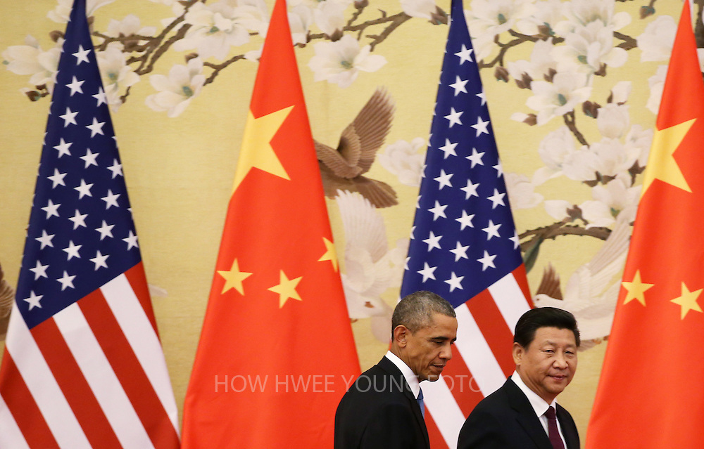 epa04486112 US President Barack Obama (L) and Chinese President Xi Jinping leave after a press conference at the Great Hall of the People (GHOP) in Beijing, China, 12 November 2014. Obama is in China to attend the Asia-Pacific Economic Cooperation (APEC) 2014 Summit and related meetings.  EPA/HOW HWEE YOUNG