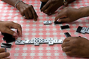 Playing dominos at a Caribbean pensioners club in North London.