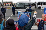 Protesters sing protest songs whilst police are deployed outside the main gate of Camp Schwab, a US Marine Corps base. The police come out in force when vehicles, often trucks carrying building material, are about to enter the US Military Base. <br /> <br /> In Okinawa, older women are on the front lines of the military base protest movement, they protect from the sun with hats and gloves.<br /> <br /> Protestors, outside the US Marine Corps Camp Schwab base, rally against the expansion of the facility. New construction will double the size of the current base, creating a US military mega-base that will include two airstrips. Plans are afoot to reclaim land in the surrounding sea to achieve this. Preparations for construction has already started but demonstrators assert construction can still be stopped.<br /> <br /> USMC Camp Schwab. Named after Battle of Okinawa hero, Albert E. Schwab, and built upon a former civilian internment camp, the remains of approximately 300 Okinawans still lie within the base. During the Cold War, the installation and its adjacent arsenal, stored nuclear warheads and, veterans say, a large cache of Agent Orange. Today live fire training and sea drills are held here. The proposed site for operations relocated from MCAS Futenma, the USMC envisages a new base with twin runways and a deepwater port. The Japanese government contends the environmental impact will be minimal but many Okinawans - Governor Takeshi Onaga included - argue that the millions of tons of landfill will cause irrevocable damage to the sea.<br /> <br /> Size: 20.6 sq km   Japanese base workers: 242