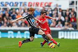 Joe Allen of Liverpool is challenged by Jack Colback of Newcastle United - Photo mandatory by-line: Rogan Thomson/JMP - 07966 386802 -01/11/2014 - SPORT - FOOTBALL - Newcastle, England - St James' Park - Newcastle United v Liverpool - Barclays Premier League.