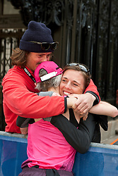 2013 Boston Marathon: Joan Benoit Samuelson gets hugs from her son Anders, daughter Abby after finishing