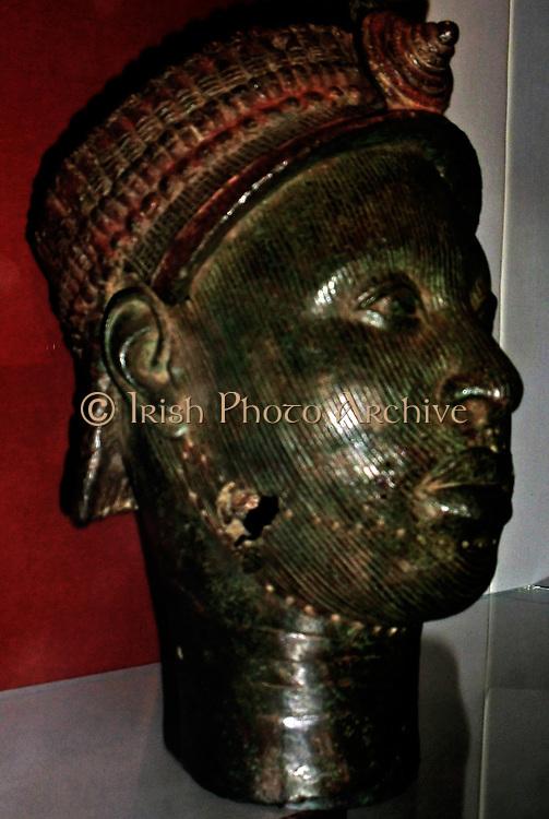 Cast brass head with red pigment Ife, Yoruba people, Nigeria.  12-15th century