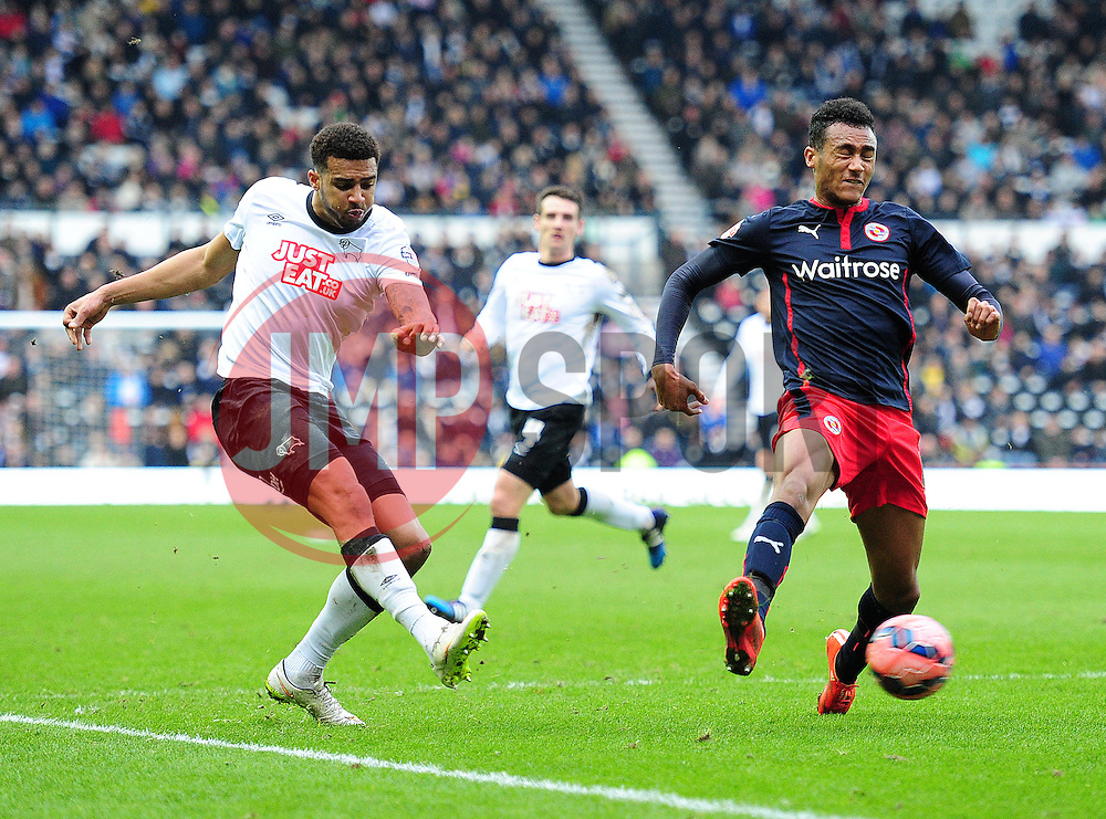 Derby County's Cyrus Christie crosses the ball past Reading's Jordan Obita - Photo mandatory by-line: Alex James/JMP - Mobile: 07966 386802 - 14/02/2015 - SPORT - Football - Derby  - ipro stadium - Derby County v Reading - FA Cup - Fifth Round