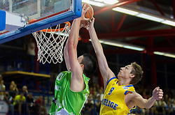 Alen Omic of Slovenia vs Marcus Eriksson of Sweden during basketball match between National teams of Sweden and Slovenia in First Round of U20 Men European Championship Slovenia 2012, on July 13, 2012 in Domzale, Slovenia. (Photo by Vid Ponikvar / Sportida.com)