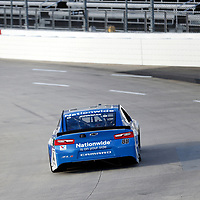 Alex Bowman (88) races through turn three to practice  for the First Data 500 at Martinsville Speedway in Martinsville, Virginia.