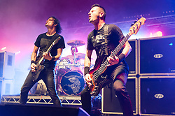 © Licensed to London News Pictures. 29/08/2015. Reading Festival, UK.  Gojira performing at Reading Festival 2015, Day 2.  In this picture - Joe Duplantier (left), Jean-Michel Labadie (right).  Photo credit: Richard Isaac/LNP