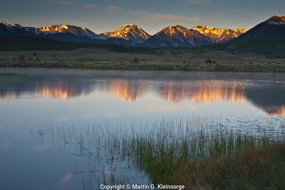 Reflections of the Sawatch Range in a reservoir in the Upper Arkansas Valley.  Colorado, USA.