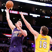 10 December 2013: Phoenix Suns center Miles Plumlee (22) goes for the skyhook over Los Angeles Lakers center Pau Gasol (16) during the Phoenix Suns 114-108 victory over the Los Angeles Lakers at the Staples Center, Los Angeles, California, USA.