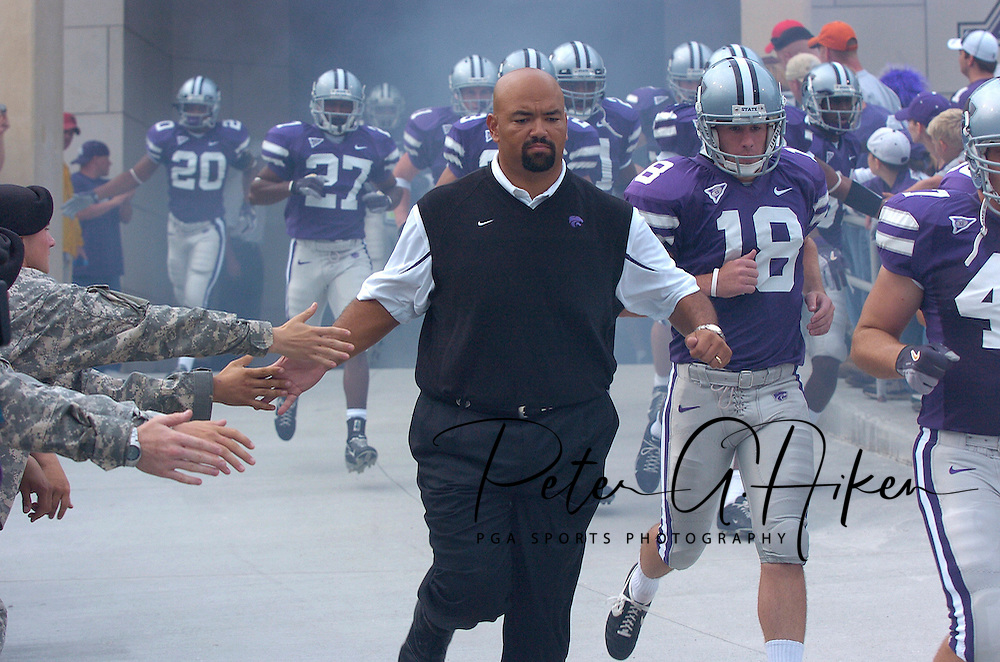 Kansas State head coach Ron Prince runs down the ramp, slapping hands with Soldiers from Fort Riley at Bill Snyder Family Stadium in Manhattan, Kansas, September 9, 2006.  The Wildcats beat the Owls 45-0.