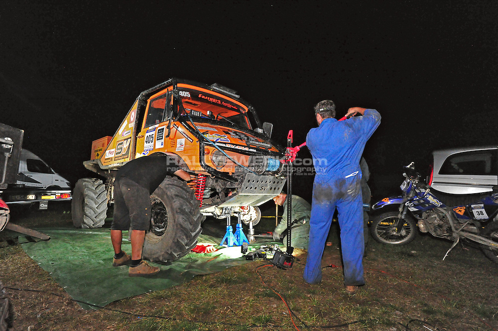 19. Rallye Breslau 2012.#405 - Sebastien Poncet and Tony Daudet work into the night to fix their Unimog with their crew..© Robert W. Kranz / Rallyewerk