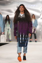 © Licensed to London News Pictures. 02/06/2014. London, England. De Montfort University Leicester, collection by Rebecca Chipping. Graduate Fashion Week 2014, Runway Show at the Old Truman Brewery in London, United Kingdom. Photo credit: Bettina Strenske/LNP