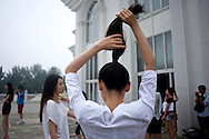 Contestants for the Miss Universe China Pageant  are styled for a photo shoot at a training camp for contestants in Beijing, China on Thursday, June 23, 2011.   The training camp was created by cosmetics businesswoman and Chinese-American television personality Yue-Sai Kan's to give China, which has never won a Ms. Universe Contest, a cpotential contender in the upcoming beauty pagent.
