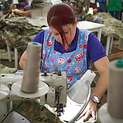 JUNE 28, 2016 --- COROZAL, PUERTO RICO<br /> Rosa Otero Figueroa works in a production line at Bluewater Defense in Corozal. The company makes pants for the US Army.<br /> (Photo by Angel Valentin/Freelance)