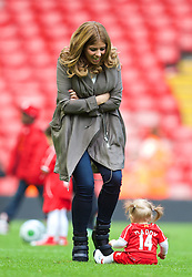 LIVERPOOL, ENGLAND - Sunday, May 11, 2014: Rebecca Burnett, the wife of Jordan Henderson with their daughter Elexa after the Premiership match against Newcastle United at Anfield. (Pic by David Rawcliffe/Propaganda)