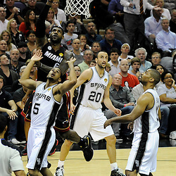Jun 13, 2013; San Antonio, TX, USA; Miami Heat small forward LeBron James (6) shoots against San Antonio Spurs point guard Cory Joseph (5) during the first quarter of game four of the 2013 NBA Finals at the AT&T Center. Mandatory Credit: Derick E. Hingle-USA TODAY Sports
