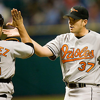 Baltimore Orioles pitcher Chris Ray (R) celebrates with catcher Ramon Hernandez (L) after defeating the Tampa Bay Devil Rays, 6-3, during their American League game at Tropicana Field in St. Petersburg, Florida on April 10, 2006. REUTERS/Scott Audette