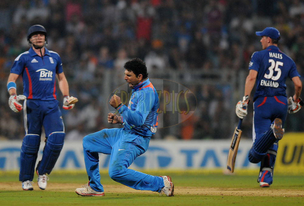 Yuvraj Singh of India celebrates the wicket of Luke Wright of England during the 2nd Airtel T20 Match between India and England held at The Wankhede Stadium in Mumbai on the 22nd December 2012..Photo by Pal PIllai/BCCI/SPORTZPICS ..Use of this image is subject to the terms and conditions as outlined by the BCCI. These terms can be found by following this link:..http://www.sportzpics.co.za/image/I0000SoRagM2cIEc