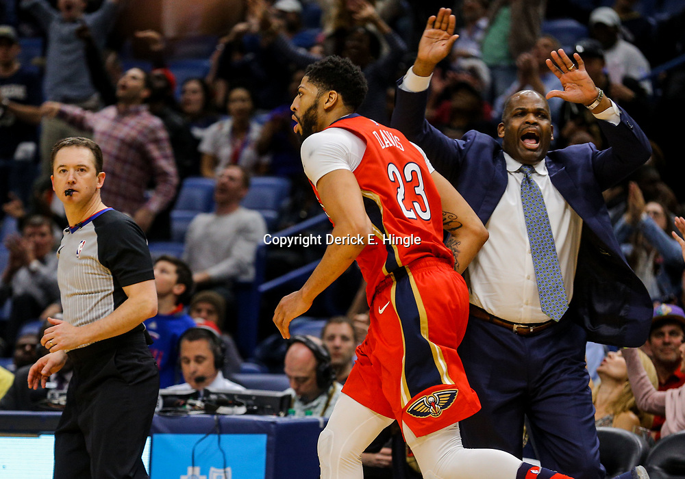 Mar 21, 2018; New Orleans, LA, USA; New Orleans Pelicans forward Anthony Davis (23) runs past Indiana Pacers head coach Nate McMillan after a three point basket during the fourth quarter at the Smoothie King Center. The Pelicans defeated the Pacers 96-92. Mandatory Credit: Derick E. Hingle-USA TODAY Sports
