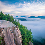 Early risers await the sunrise on Cathedral Ledge in North Conway, NH
