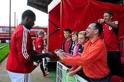 Bristol City's Jay Emmanuel-Thomas signs autographs  - Photo mandatory by-line: Dougie Allward/JMP - Tel: Mobile: 07966 386802 27/08/2013 - SPORT - FOOTBALL - Ashton Gate - Bristol - Bristol City V Crystal Palace -  Capital One Cup - Round 2
