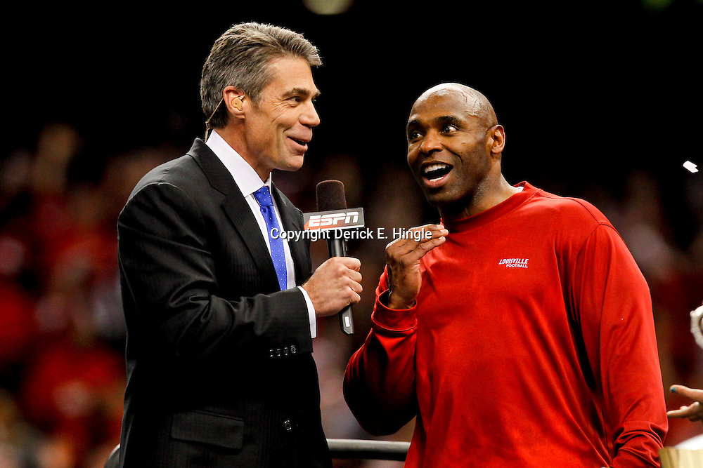 Jan 2, 2013; New Orleans, LA, USA; Chris Fowler of ESPN interviews Louisville Cardinals head coach Charlie Strong after winning the Sugar Bowl against the Florida Gators at the Mercedes-Benz Superdome. Louisville defeated Florida 33-23. Mandatory Credit: Derick E. Hingle-USA TODAY Sports