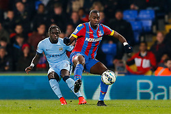 Yannick Bolasie of Crystal Palace is challenged by Bacary Sagna of Manchester City - Photo mandatory by-line: Rogan Thomson/JMP - 07966 386802 - 06/04/2015 - SPORT - FOOTBALL - London, England - Selhurst Park - Crystal Palace v Manchester City - Barclays Premier League.